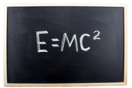 Formula written in chalk on blackboard photo
