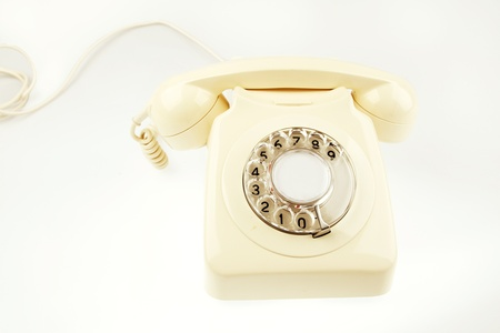 rotary dial telephone: Antiguo tel?no de marcaci?otativa en fondo liso