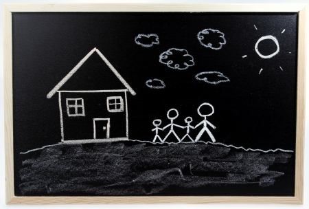 House and family on chalkboard  Stock Photo