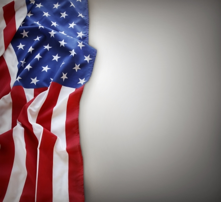 Closeup of American flag on plain background  Copy space