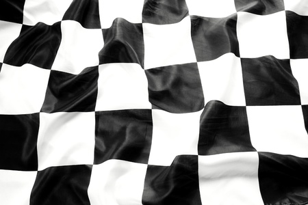 Checkered black and white flag closeup photo