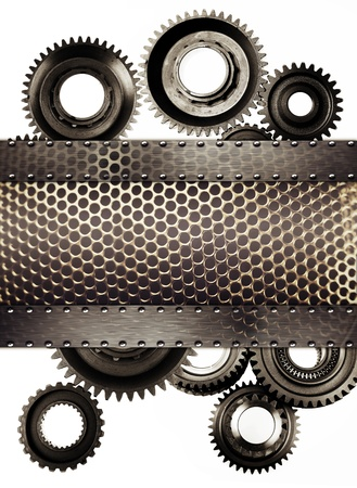 Cog wheel gears and metal grill photo