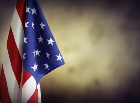 state government: American flag in front of plain background. Advertising space