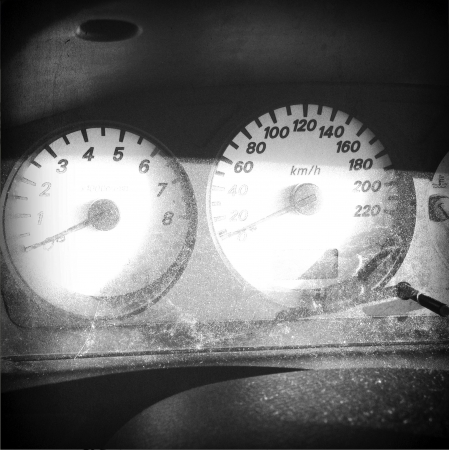 rev: Speedometer and rev counter in car dashboard