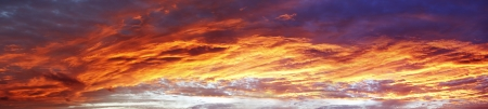 Bright orange sunset clouds in sky photo