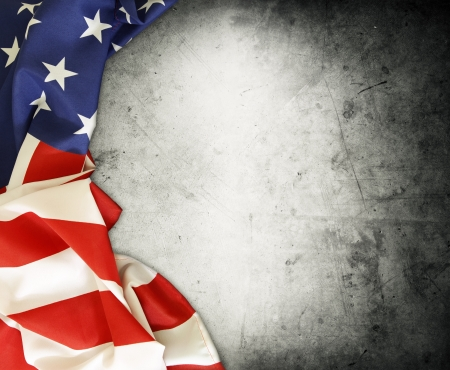 american flag: Closeup of American flag on grey background