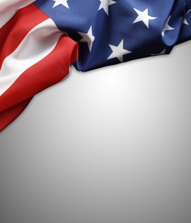 Closeup of American flag on plain background  Copy space photo
