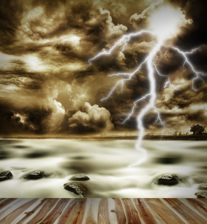Boardwalk, sea, lightning in sky photo