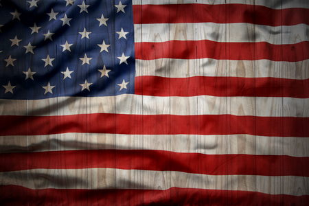 Closeup of American flag on fence background photo