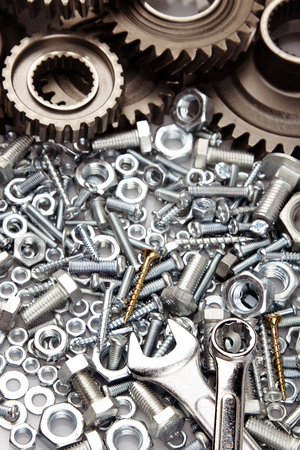 metal parts: Steel gears, nuts, bolts, and wrenches
