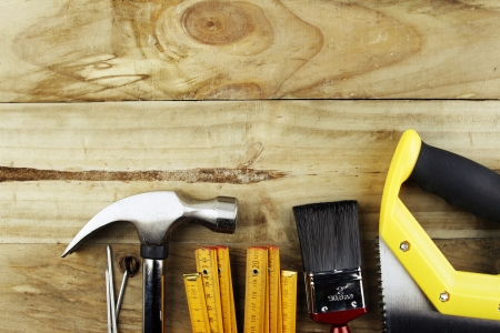 Closeup of assorted work tools on wood photo
