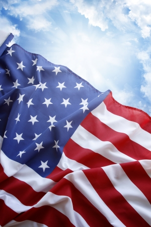 青い空の前にアメリカの国旗 写真素材