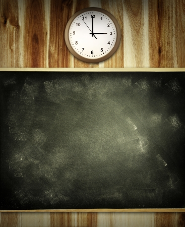 Clock and chalkboard on wall  Advertising copy space photo