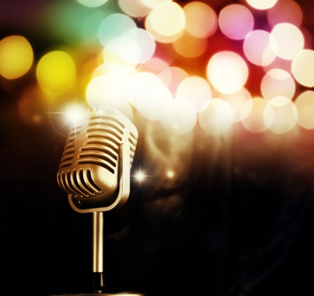 Microphone in front of bright lights photo