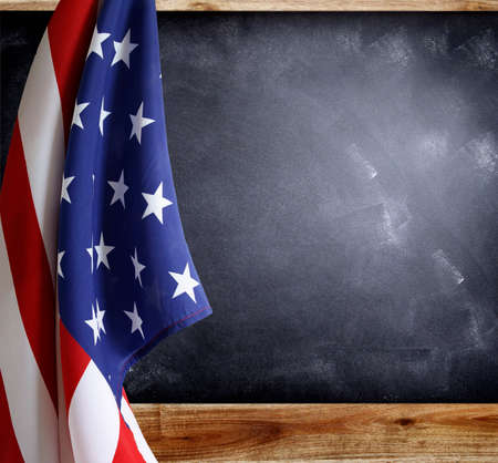 American flag in front of blackboard photo