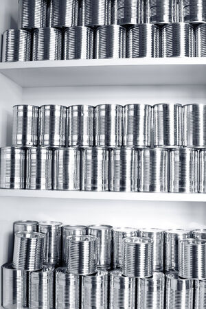 pantry: Tin cans stacked on shelves Stock Photo