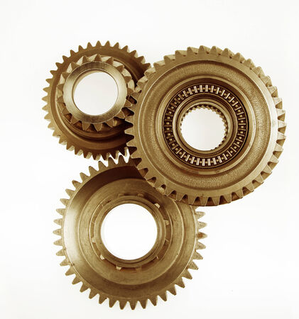 cogs: Three metal cog gears together Stock Photo