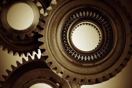 Three metal cog gears together photo