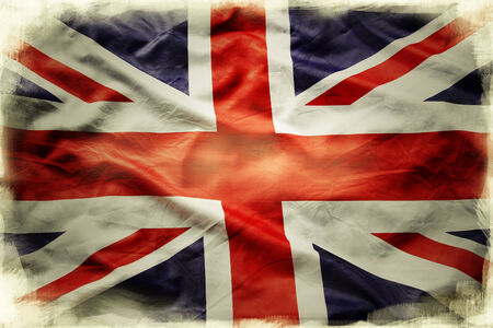 Closeup of grunge Union Jack flag photo