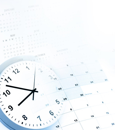 annual events: Clock face and calendars composite. Copy space