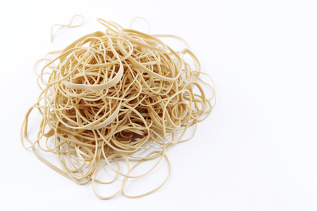 rubber bands: Pile of rubber bands on plain background  Stock Photo