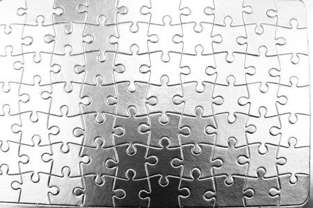 Closeup of jigsaw puzzle pattern photo
