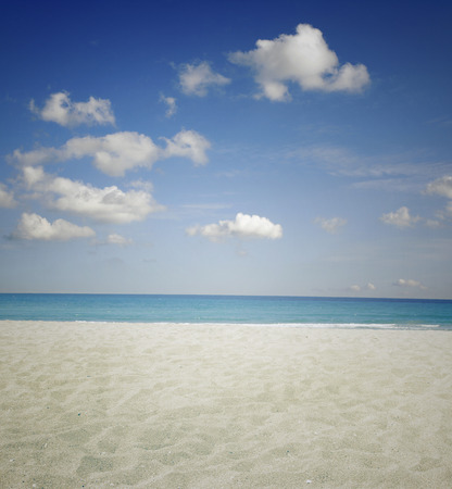 Sand, water and sky beach scenery photo