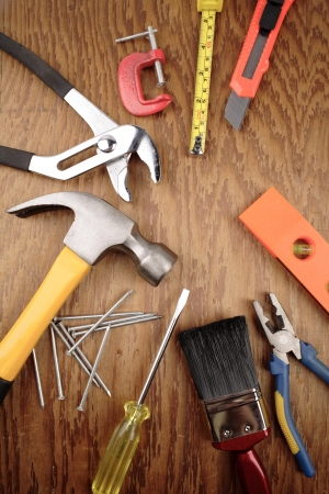 Assorted work tools on wood photo
