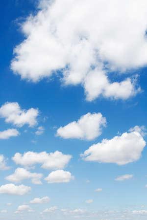 cumulus cloud: Fluffy clouds in a blue sky Stock Photo