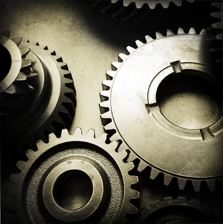 cog wheels: Metal cog gears joining together