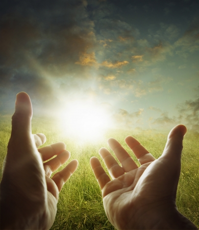 spiritual light: Hands reaching for the sky
