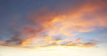 dramatic clouds: Orange and blue colors in sky Stock Photo
