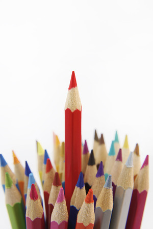 Red pencil standing out from others photo