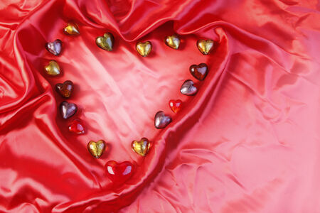 Glass love hearts on silk photo