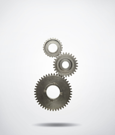 cogs: Three metal cog gears joining together