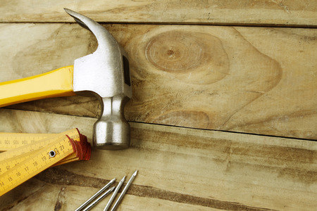 Hammer, nails and ruler on wood photo