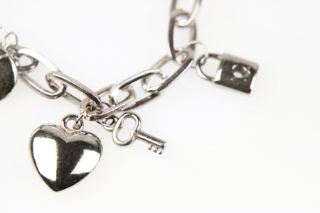 Closeup of heart and key on charm bracelet