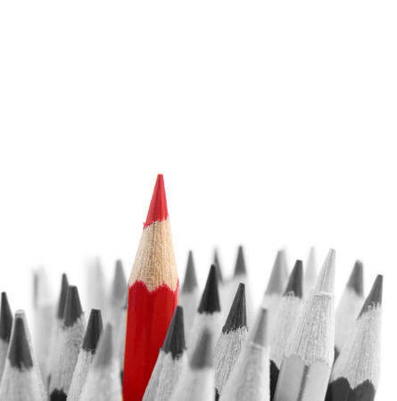 standing out from the crowd: Red pencil standing out from others