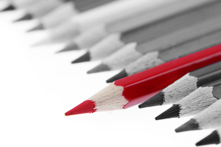 standout: One red pencil standing out from others Stock Photo