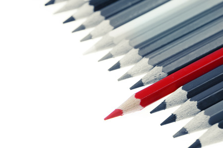 individualist: One red pencil standing out from others Stock Photo
