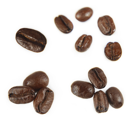 Closeup of coffee beans on plain background Stock Photo - 25798880