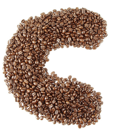 Letter C made up  of coffee beans on plain background photo