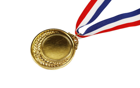 gold medal: Closeup of golden medal on plain background Stock Photo