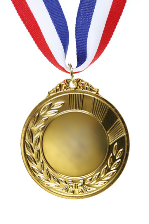 Closeup of golden medal on plain background photo