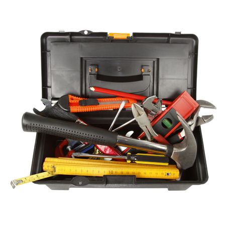 Tools in open toolbox on plain  photo
