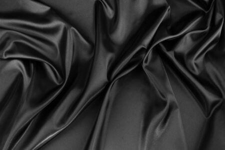 Closeup of rippled black silk fabric photo