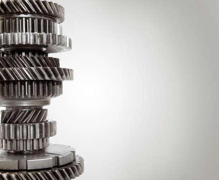 cog wheels: Steel cogs together on plain background