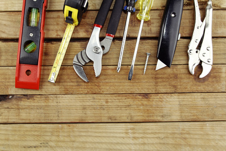 workbench: Assorted work tools on wood