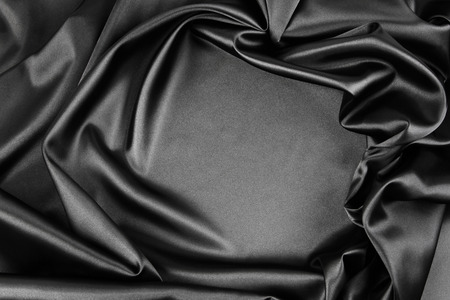 black satin: Closeup of rippled black silk fabric