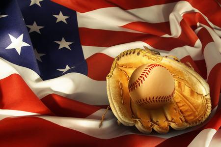 Baseball in glove on American flag photo